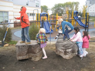 Playing on EECS playground during community celebration of green school grounds